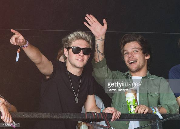 Niall Horan and Louis Tomlinson of One Direction watch James Bay perform at the Glastonbury Festival at Worthy Farm Pilton on June 26 2015 in...