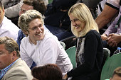 Niall Horan from band One Direction watches the action at Rod Laver Arena during day 14 of the 2015 Australian Open at Melbourne Park on February 1...