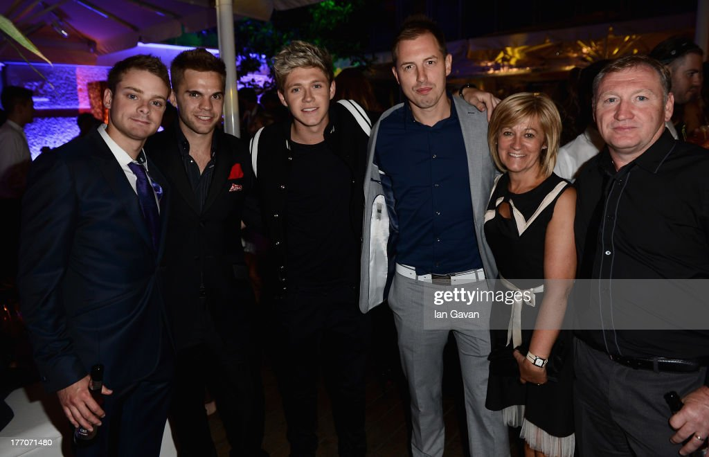 <a gi-track='captionPersonalityLinkClicked' href=/galleries/search?phrase=Niall+Horan&family=editorial&specificpeople=7229827 ng-click='$event.stopPropagation()'>Niall Horan</a> from One Direction (third left), his parents Maura Gallagher and Chris Gallagher (R) and guests attend the 'One Direction This Is Us' world premiere after party on August 20, 2013 in London, England.