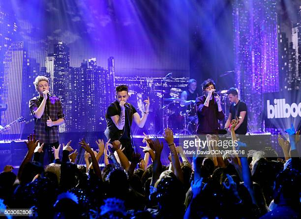 Niall Horan Liam Payne and Louis Tomlinson of One Direction perform onstage at Dick Clark's New Year's Rockin' Eve with Ryan Seacrest 2016 on...