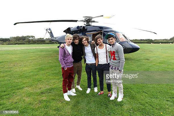 LR Niall Horan Louis Tomlinson Harry Styles Liam Payne and Zain Malik of One Direction travel in a luxury helicopter to Glasgow Manchester and London...