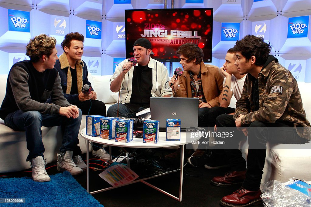 Niall Horan, Louis Tomlinson, Harry Styles, Zayn Malik of One Direction and , Dj JJ attend the Z100 Artist Gift Lounge Presented by Pop Tarts at Z100's Jingle Ball 2012 at Madison Square Garden on December 7, 2012 in New York City.