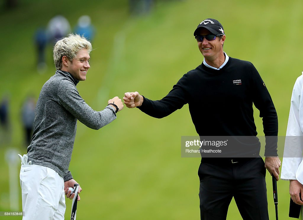 <a gi-track='captionPersonalityLinkClicked' href=/galleries/search?phrase=Niall+Horan&family=editorial&specificpeople=7229827 ng-click='$event.stopPropagation()'>Niall Horan</a> of One Direction celebrates with <a gi-track='captionPersonalityLinkClicked' href=/galleries/search?phrase=Nicolas+Colsaerts&family=editorial&specificpeople=216573 ng-click='$event.stopPropagation()'>Nicolas Colsaerts</a> of Belgium during the Pro-Am prior to the BMW PGA Championship at Wentworth on May 25, 2016 in Virginia Water, England.