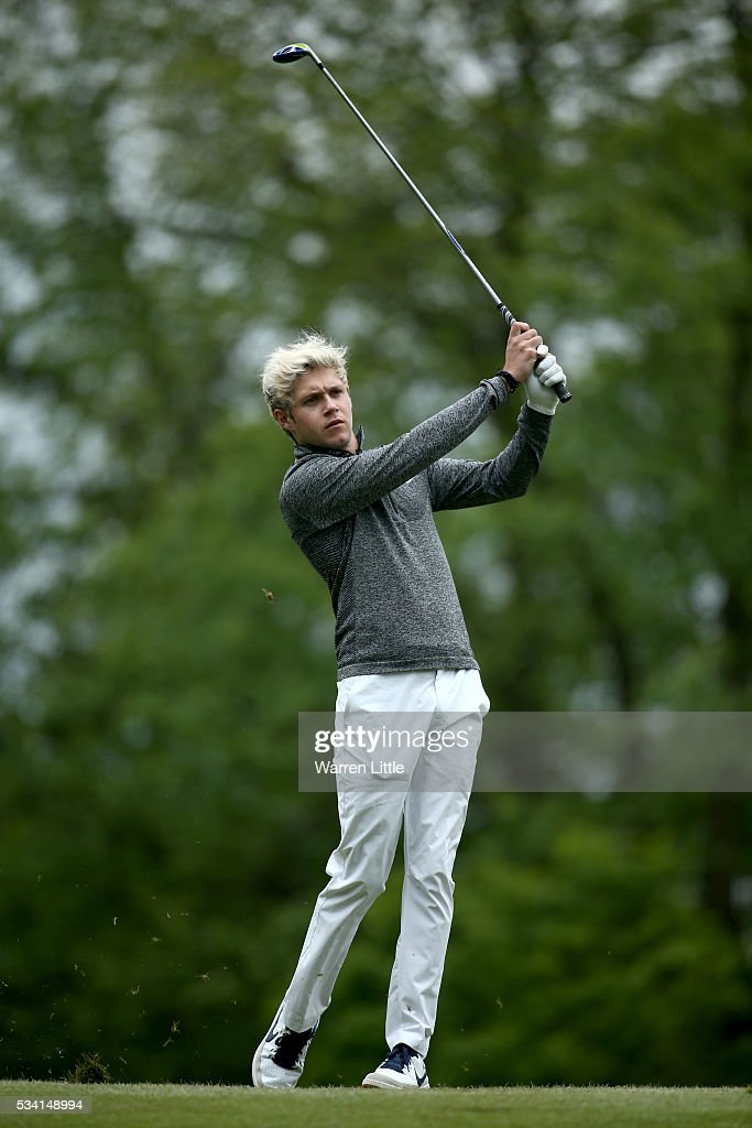<a gi-track='captionPersonalityLinkClicked' href=/galleries/search?phrase=Niall+Horan&family=editorial&specificpeople=7229827 ng-click='$event.stopPropagation()'>Niall Horan</a> of One Direction in action during the Pro-Am prior to the BMW PGA Championship at Wentworth on May 25, 2016 in Virginia Water, England.