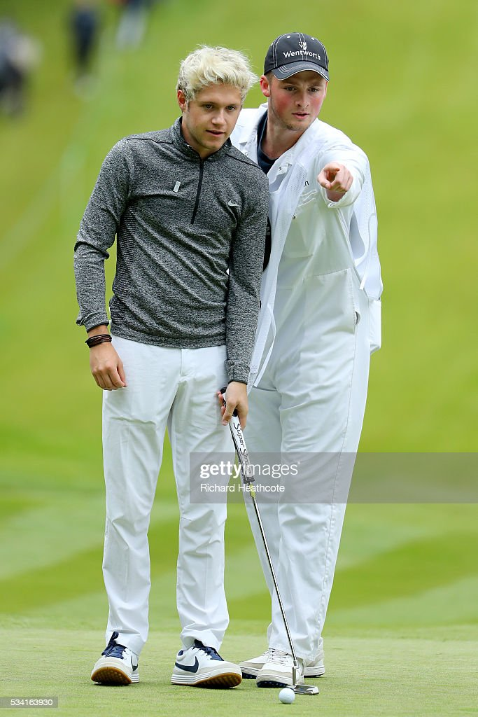 <a gi-track='captionPersonalityLinkClicked' href=/galleries/search?phrase=Niall+Horan&family=editorial&specificpeople=7229827 ng-click='$event.stopPropagation()'>Niall Horan</a> of One Direction lines up during the Pro-Am prior to the BMW PGA Championship at Wentworth on May 25, 2016 in Virginia Water, England.