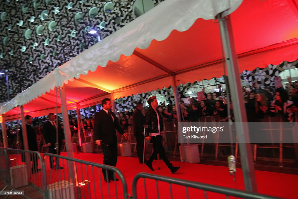 <a gi-track='captionPersonalityLinkClicked' href=/galleries/search?phrase=Zayn+Malik&family=editorial&specificpeople=7298822 ng-click='$event.stopPropagation()'>Zayn Malik</a> of One Direction meets the fans ahead of The BRIT Awards 2014 at 02 Arena on February 19, 2014 in London, England.