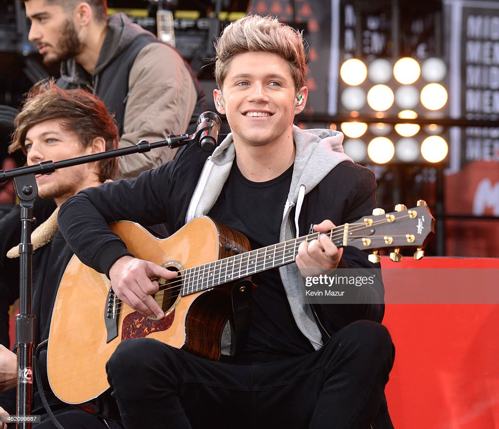 Niall Horan of One Direction performs on ABC's 'Good Morning America' at Rumsey Playfield, Central Park on November 26, 2013 in New York City.