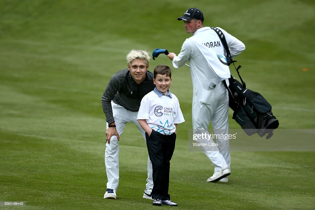 <a gi-track='captionPersonalityLinkClicked' href=/galleries/search?phrase=Niall+Horan&family=editorial&specificpeople=7229827 ng-click='$event.stopPropagation()'>Niall Horan</a> of One Direction poses for a picture during the Pro-Am prior to the BMW PGA Championship at Wentworth on May 25, 2016 in Virginia Water, England.