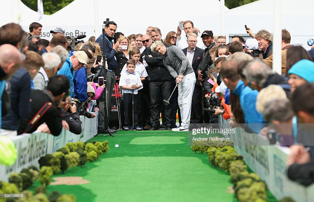 <a gi-track='captionPersonalityLinkClicked' href=/galleries/search?phrase=Niall+Horan&family=editorial&specificpeople=7229827 ng-click='$event.stopPropagation()'>Niall Horan</a> of One Direction putts at the launch of the Totally Mega Putt Challenge initiative in the Championship Village prior to the BMW PGA Championship at Wentworth on May 25, 2016 in Virginia Water, England.