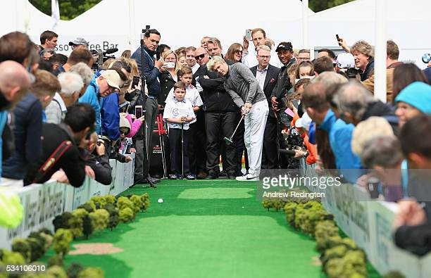 Niall Horan of One Direction putts at the launch of the Totally Mega Putt Challenge initiative in the Championship Village prior to the BMW PGA...