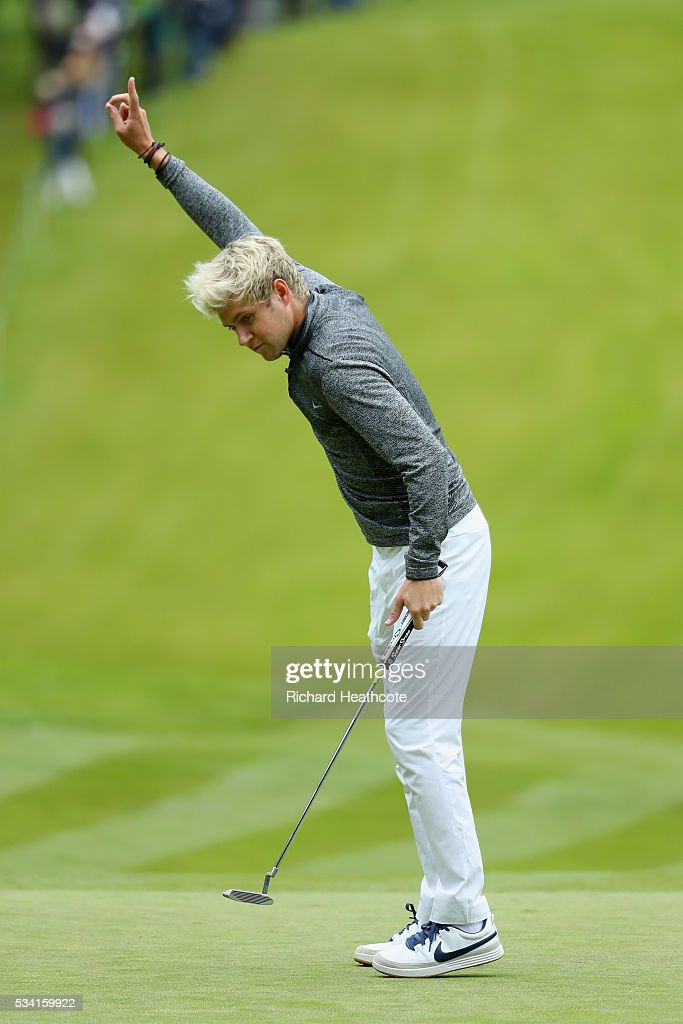 <a gi-track='captionPersonalityLinkClicked' href=/galleries/search?phrase=Niall+Horan&family=editorial&specificpeople=7229827 ng-click='$event.stopPropagation()'>Niall Horan</a> of One Direction reacts to a putt during the Pro-Am prior to the BMW PGA Championship at Wentworth on May 25, 2016 in Virginia Water, England.