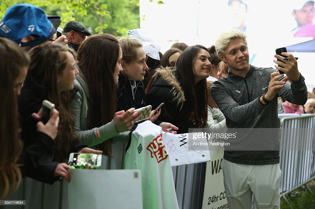 <a gi-track='captionPersonalityLinkClicked' href=/galleries/search?phrase=Niall+Horan&family=editorial&specificpeople=7229827 ng-click='$event.stopPropagation()'>Niall Horan</a> of One Direction takes a selfie with fans after the Pro-Am prior to the BMW PGA Championship at Wentworth on May 25, 2016 in Virginia Water, England.