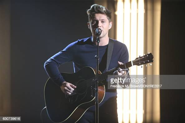 Niall Horan performs at Dick Clark's New Year's Rockin' Eve with Ryan Seacrest on December 31 2016 in Los Angeles California