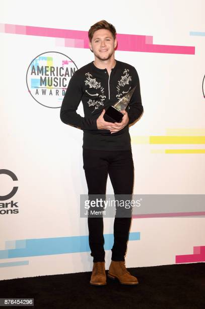 Niall Horan poses in the press room during 2017 American Music Awards at Microsoft Theater on November 19 2017 in Los Angeles California