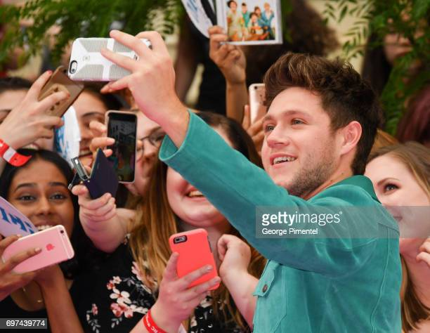 Niall Horan poses with fans at the 2017 iHeartRADIO MuchMusic Video Awards at MuchMusic HQ on June 18 2017 in Toronto Canada