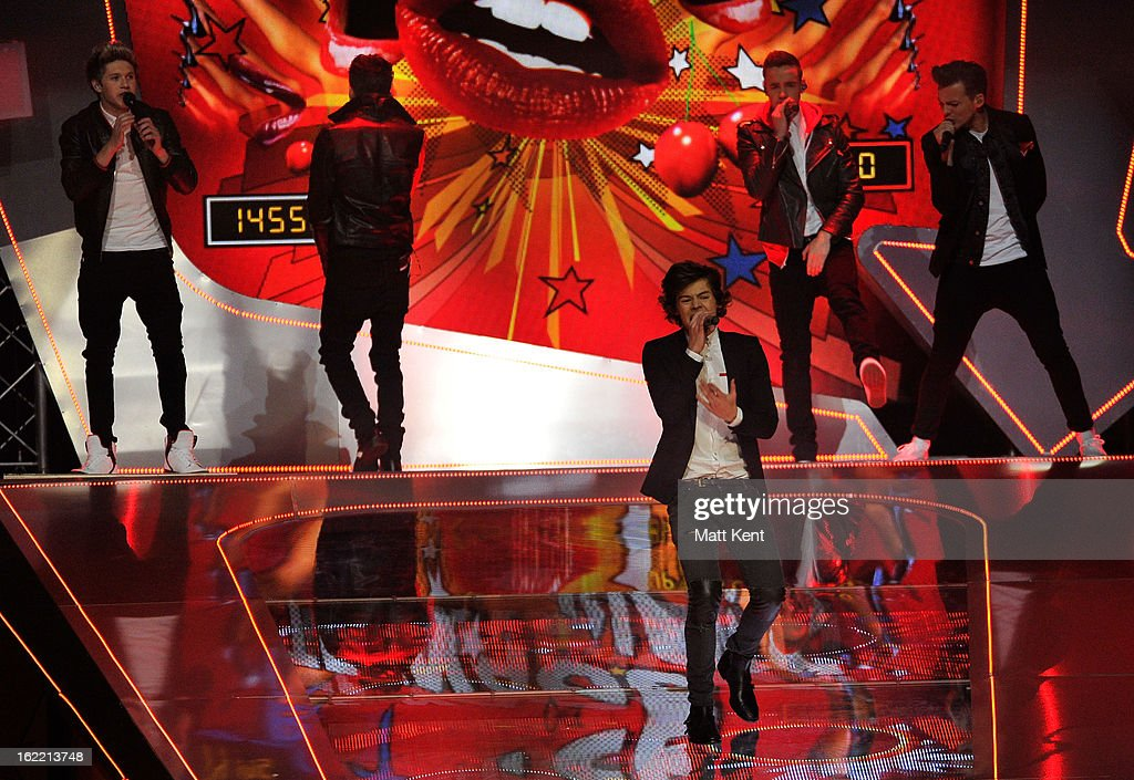 Niall Horan, Zayn Malik, Harry Styles, Liam Payne and Louis Tomlinson perform on stage during the Brit Awards 2013 at the 02 Arena on February 20, 2013 in London, England.