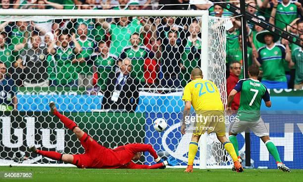 Niall McGinn of Northern Ireland scores his team's first goal past Andriy Pyatov of Ukraine during the UEFA EURO 2016 Group C match between Ukraine...