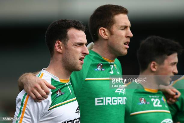 Niall Morgan and Gary Brennan of Ireland look on during the national anthems during game two of the International Rules Series between Australia and...