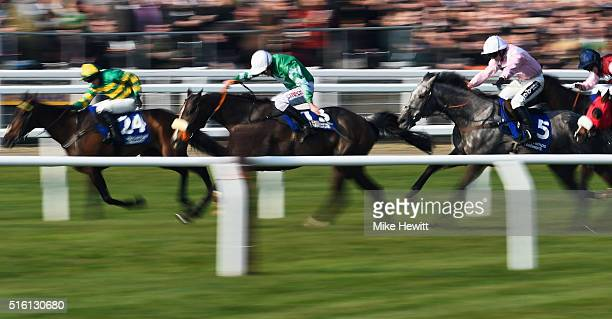 Niall P Madden on Rathpatrick eventual winner Davy Russell on Mall Dini and Sean Bowen on Arpege D'Alene race to the finish line in the Pertemps...