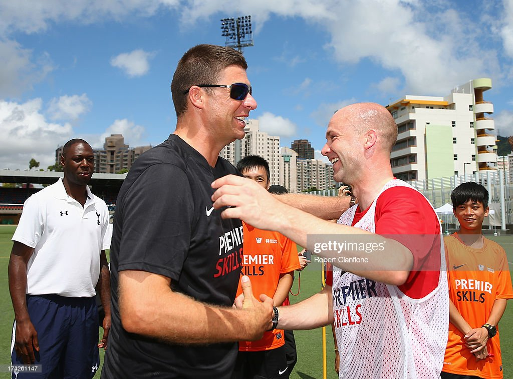 Niall Quinn greets referee Anthony Taylor during the Premier Skills and Creating Chances open day on July 23, 2013 in Hong Kong, Hong Kong.