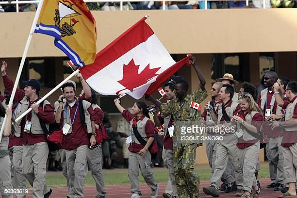 Canadian athletes parade at the opening ceremony of the Jeux de la Francophonie at Seny Kountche stadium in Niamey 07 December 2005 AFP PHOTO ISSOUF...