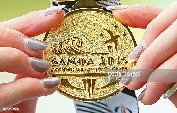 Niamh Emerson of England holds her gold medal after the medal presentation for the Girls High Jump during the Athletics at the Apia Park Sports...