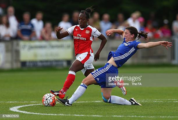 Niamh Fahey of Chelsea Ladies FC tackles Danielle Carter of Arsenal Ladies during the FA WSL 1 match between Chelsea Ladies FC and Arsenal Ladies at...