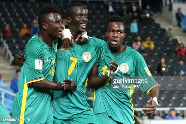 Niane Ibrahima celebrates with teammates after scoring his team's first goal during the FIFA U20 World Cup Korea Republic 2017 group F match between...