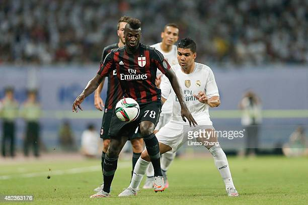 Niang M'baye Hamady of AC Milan contests the ball against Casemiro of Real Madrid during the International Champions Cup match between Real Madrid...