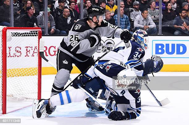 Nic Dowd of the Los Angeles Kings battles in front of the net against Dustin Byfuglien of the Winnipeg Jets during the game on January 14 2017 at...