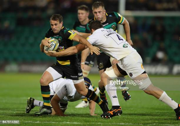 Nic Groom of Norhampton is tackled by Charlie Ewels uring the Aviva Premiership match between Northampton Saints and Bath Rugby at Franklin's Gardens...
