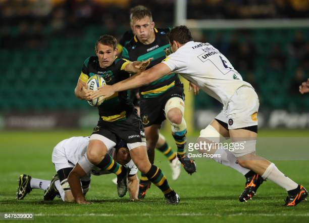 Nic Groom of Northampton is tackled by Charlie Ewels during the Aviva Premiership match between Northampton Saints and Bath Rugby at Franklin's...