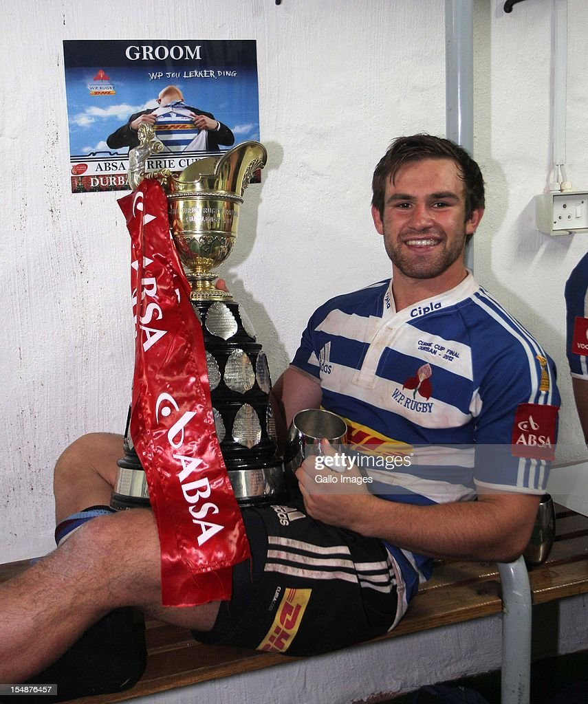 Nic Groom of Western Province celebrates with the trophy after the Absa Currie Cup final match between The Sharks and DHL Western Province from Mr Price KINGS PARK on October 27, 2012 in Durban, South Africa.