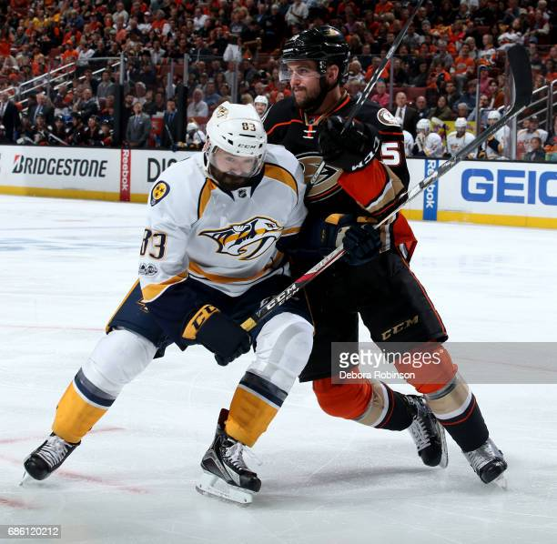 Nic Kerdiles of the Anaheim Ducks battles for position against Vernon Fiddler of the Nashville Predators in Game Five of the Western Conference Final...