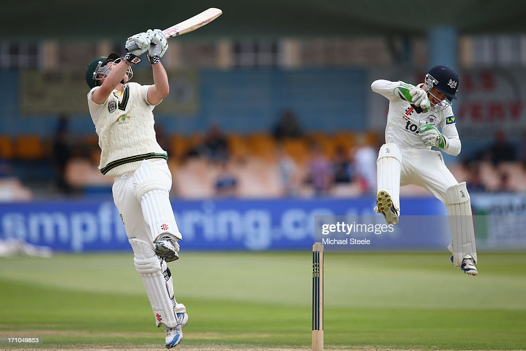 Nic Maddinson (L) of Australia A and Cameron Herring (R) the wicketkeeper of Gloucestershire leap high at a rising ball during day one of the Gloucestershire versus Australia A tour match at The County Ground on June 21, 2013 in Bristol, England.