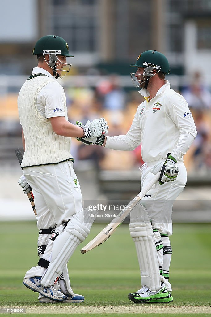 Nic Maddinson (L) of Australia A shakes hands with Phil Hughes (R) after reaching his century during day one of the Gloucestershire versus Australia A tour match at The County Ground on June 21, 2013 in Bristol, England.