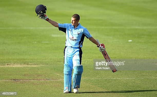 Nic Maddinson of the Blues acknowledges the crowd after scoring a century during the Matador BBQs One Day Cup match between Tasmania and New South...
