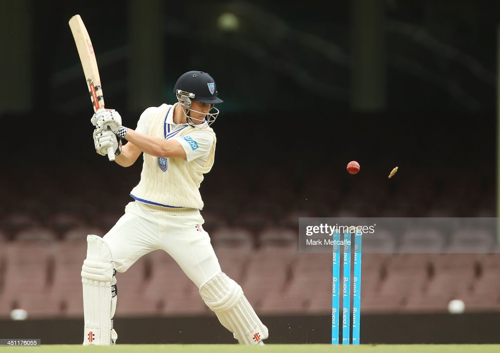 Nic Maddinson of the Blues is bowled by Matthew Gale of the Bulls during day one of the Sheffield Shield match between the New South Wales Blues and the Queensland Bulls at Sydney Cricket Ground on November 22, 2013 in Sydney, Australia.