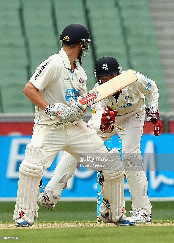 Nic Maddinson of the Blues is stumped by Peter Handscomb of the Bushrangers off the bowling of Fawad Ahmed of the Bushrangers during day one of the Sheffield Shield match between the Victorian Bushrangers and the New South Wales Blues at Melbourne Cricket Ground on March 7, 2013 in Melbourne, Australia.