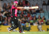 Nic Maddinson of the Sixers bats during the Big Bash League match between Sydney Thunder and the Sydney Sixers at ANZ Stadium on January 25 2014 in...