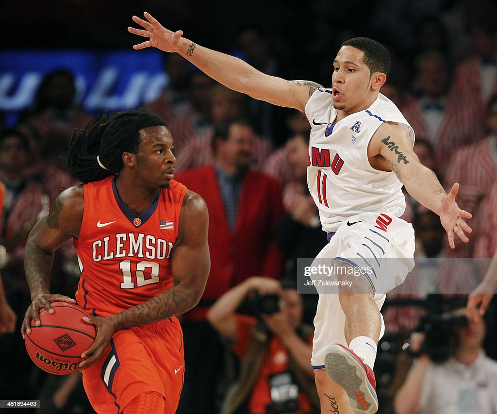 Nic Moore #11 of the Southern Methodist Mustangs guards Rod Hall #12 of the Clemson Tigers during the NIT Championship semifinals at Madison Square Garden on April 1, 2014 in New York City.