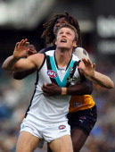 Nic Naitanui of the Eagles and Dean Brogan of the Power contest the ruck during the round 13 AFL match between the West Coast Eagles and Port...