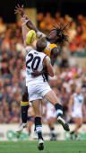 Nic Naitanui of the Eagles and Dean Brogan of the Power contest the ruck during the round two AFL match between the West Coast Eagles and Port...