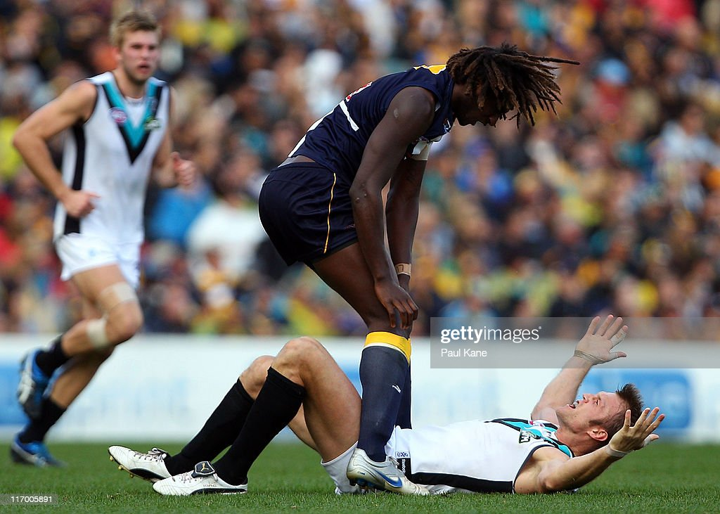 Nic Naitanui of the Eagles and Dean Brogan of the Power wrestle during the round 13 AFL match between the West Coast Eagles and Port Adelaide Power...