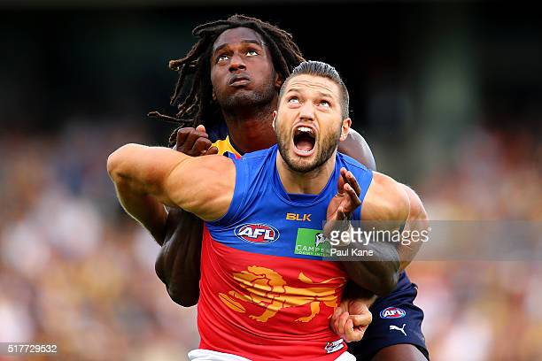 Nic Naitanui of the Eagles and Stefan Martin of the Lions contest the ruck during the AFL round one match between the West Coast Eagles and the...