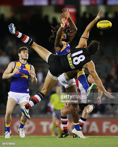 Nic Naitanui of the Eagles competes for the ball against Billy Longer of the Saints who takes a tumble during the round 14 AFL match between the St...