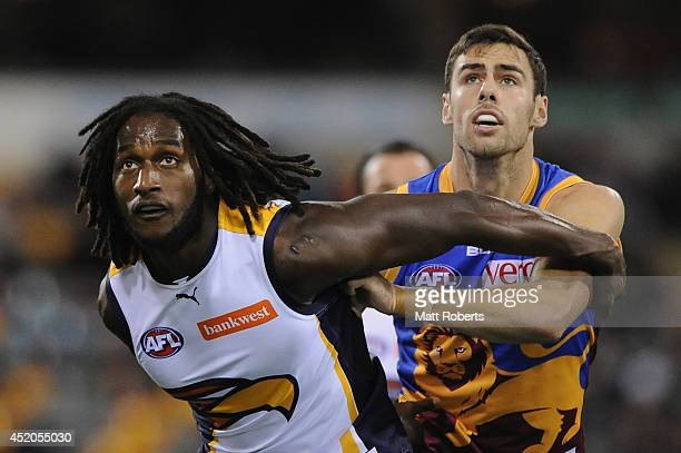 Nic Naitanui of the Eagles competes for the ball with Michael Close of the Lions during the round 17 AFL match between the Brisbane Lions and the...