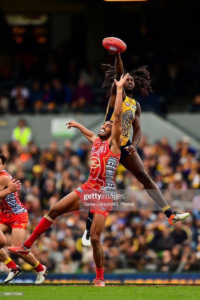 Nic Naitanui of the Eagles contests a ruck with Tom Nicholls of the Suns during the 2016 AFL Round 10 match between the West Coast Eagles and the Gold Coast Suns at Domain Stadium on May 29, 2016 in Perth, Australia.