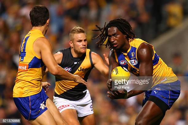 Nic Naitanui of the Eagles handballs to Liam Duggan of the Eagles during the round four AFL match between the West Coast Eagles and the Richmond...