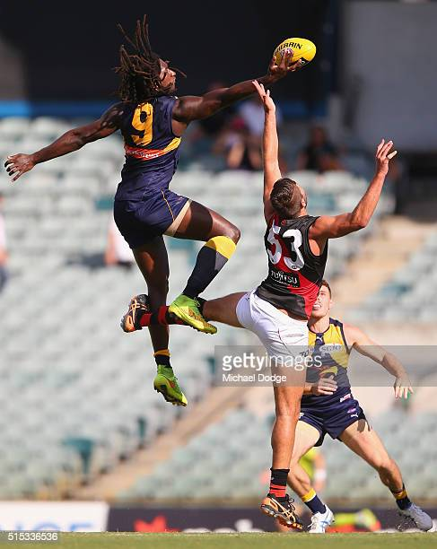 Nic Naitanui of the Eagles leaps over Mark Jamar of the Bombers in a ruck contest during the NAB Challenge AFL match between the West Coast Eagles...